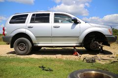 Dodge Durango SUV on Tire Jack Getting New Wheels Installed Royalty Free Stock Photo