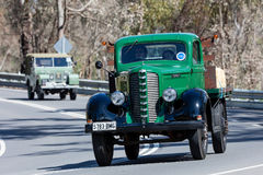 1938 Dodge Fargo Truck driving on country road. Adelaide, Australia - September 25, 2016: Vintage 1938 Dodge Fargo Truck driving on country roads near the town Stock Photography