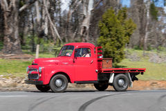 1955 Dodge Fargo Truck driving on country road. Adelaide, Australia - September 25, 2016: Vintage 1955 Dodge Fargo Truck driving on country roads near the town Stock Photos