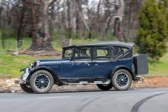 1925 Dodge Four Tourer. Adelaide, Australia - September 25, 2016: Vintage 1925 Dodge Four Tourer driving on country roads near the town of Birdwood, South Royalty Free Stock Photo
