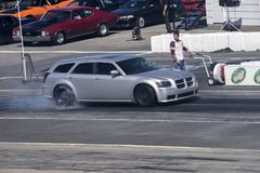 Dodge magnum making a smoke show on the track Stock Image