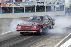 Dodge mirada burnout. Picture of vintage dodge mirada on the track making a smoke show at the starting line during the john scotti all out august 17, 2017 Stock Images