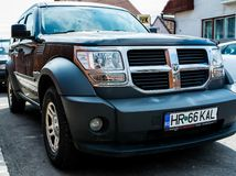 Dodge Nitro side view on a bright sunny day. stock images