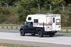 Dodge RAM 2500 Fleetwood Elkhorn camper. FRANKFURT, GERMANY - JULY 26: Dodge RAM 2500 pickup truck with a Fleetwood Elkhorn camper cabin moving fast on the royalty free stock images