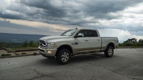 2017 Dodge Ram 2500 Diesel Longhorn. Dodge Ram 2500 Longhorn pickup truck in off white on a scenic overlook with dramatic sky. Three quarter view of the heavy royalty free stock photography