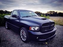 Dodge. Sophisticated Dodge Ram in a quiet and cloudy neighborhood royalty free stock photo