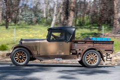 1925 Dodge 4 Utility driving on country road. Adelaide, Australia - September 25, 2016: Vintage 1925 Dodge 4 Utility driving on country roads near the town of Royalty Free Stock Photos