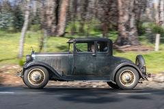 1928 Dodge Victory six coupe. Adelaide, Australia - September 25, 2016: Vintage 1928 Dodge Victory six coupe driving on country roads near the town of Birdwood Royalty Free Stock Photos