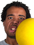 Dodgeball player getting hit on the face Stock Images