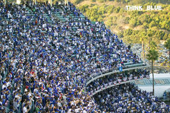 Dodger fans. In grandstands and Think Blue sign at the National League Championship Series (NLCS), Dodger Stadium, Los Angeles, CA on October 12, 2008 stock image