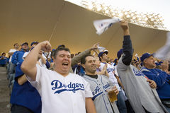 Dodger fans. Cheering during National League Championship Series (NLCS), Dodger Stadium, Los Angeles, CA on October 12, 2008 Stock Photo
