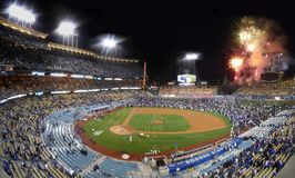 Dodger Stadium Fireworks. Photo illustration of Dodgers Stadium Fireworks after a Friday night game. Fans watch from the field as the fireworks go on Royalty Free Stock Images