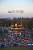 Dodger Stadium - Los Angeles Dodgers. Dodger Stadium scoreboard at dusk during a Dodgers baseball game in Los Angeles Royalty Free Stock Image