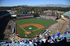 Dodger Stadium - Los Angeles Dodgers. A sunny day Dodgers baseball game at classic Dodger Stadium in Los Angeles, California. Fans are highlighted in foreground Stock Images