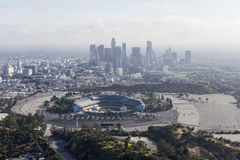 Dodger Stadium and Los Angeles Haze Aerial. Los Angeles, California, USA - April 12, 2017:  Aerial view of the historic Dodger Stadium with hazy downtown towers Stock Photo