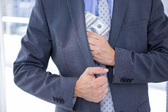 Dodgy Businessman With Dollar Bills Stock Image