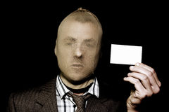 Dodgy salesman with business card Royalty Free Stock Photography