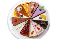 Dodici parti della torta differenti Fotografie Stock