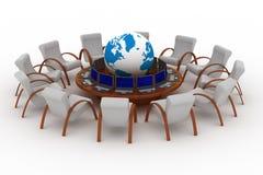 Dodici posti di lavoro dietro una tavola rotonda. Immagine Stock