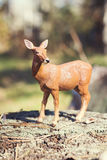 Doe in forest. Deer toy figurine in situation. Royalty Free Stock Photos