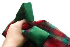 Doek van de Kerstmislijst van de persoon de afbrokkelende met hand Stock Afbeelding