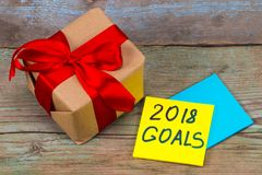 2018 doelstellingen - handschrift in zwarte inkt op een kleverige nota met gi Stock Foto