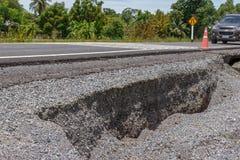 Doen ineenstorten Asphalt Road Cracked Stock Afbeelding