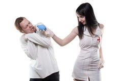 Doen schrikken patiënt en verpleegster met klysma Royalty-vrije Stock Fotografie