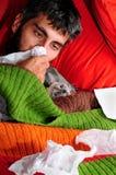 Doente em casa com o gato Fotografia de Stock