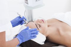Young adult woman having a mesotherapy treatment. Does anyone ready for mesotherapy? Let`s go for some beauty treatment Royalty Free Stock Images