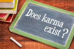 Does karma exist question on blackboard Royalty Free Stock Photo