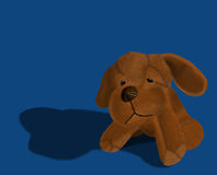 Dog. Plush toy dog on blue background Stock Photography