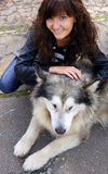 Dog Alaskan Malamute and young woman Stock Photography