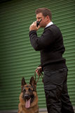 Dog Alert. A security guard and guard dog checking out the security in an industrial or commercial building stock photos