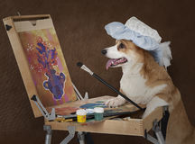 Dog artist painting still life with flowers Royalty Free Stock Images