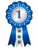 Dog award ribbon rosette. Dog competition winner silver / blue award ribbon rosette with no 1 on center Royalty Free Stock Image