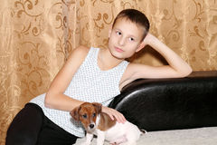 Dog baby. A child with a dog in her arms Stock Image