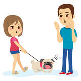 Dog Barking Man. Little bulldog dog pet barking man while walking with his girl owner Royalty Free Stock Photography