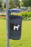 Dog bin. Bin in a park specifically designated for dog mess Stock Image