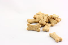 Dog Biscuits. A pile of bone shaped dog biscuits photographed on a white background Stock Photography