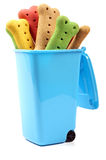 Dog biscuits in a blue bin Royalty Free Stock Photos