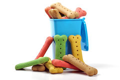 Dog biscuits and wheelie bin Royalty Free Stock Photos