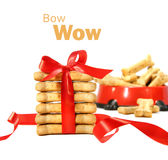 Dog biscuits  wrapped with red bow on white Royalty Free Stock Image