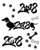 Dog. Black puppy on a white background. black & white. Logo for the year 2018. Sketch of ink. A sketch of a dog vector illustration