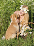 Dog and blond Royalty Free Stock Images
