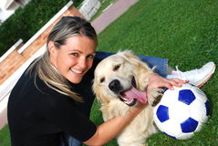 Dog and blonde girl royalty free stock photography