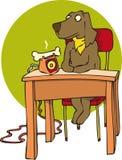 Dog and bone. Dog sitting at desk by bone shaped phone Royalty Free Stock Photo