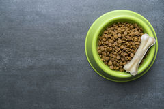 Dog bone and dog food. Dog bones and dog food on black background royalty free stock images