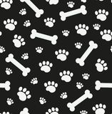 Dog bones seamless pattern. Bone and traces of puppy paws repetitive texture. Doggy endless background. Vector Royalty Free Stock Photography