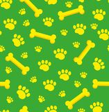 Dog bones seamless pattern. Bone and traces of puppy paws repetitive texture. Doggy endless background. Vector Royalty Free Stock Photo